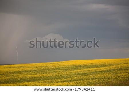 Approaching rain with lightning in scenic Saskatchewan - stock photo