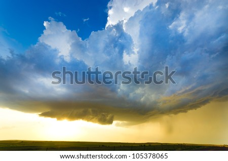 Approaching storm at the sunset - stock photo