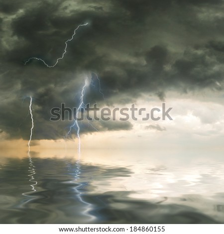 Approaching storm over the ocean with lightning - stock photo