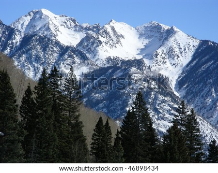 Approaching the snow capped peaks in the Rocky Mountains of Colorado - stock photo