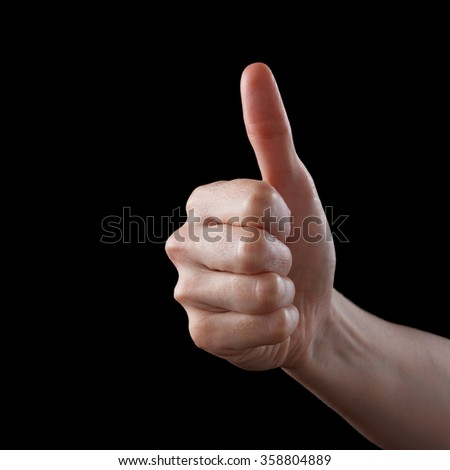 Approval thumbs up like sign as caucasian hand gesture isolated over black - stock photo