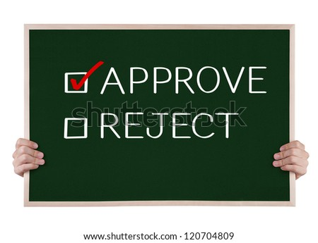 approve selected on blackboard with hands - stock photo