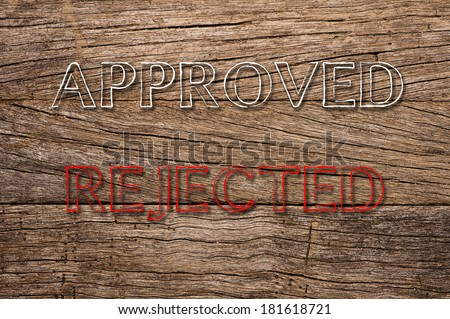 Approved and Rejected written on wooden background - stock photo