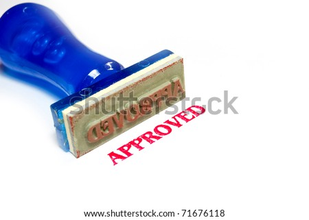 approved letter on blue rubber stamp isolated on white background - stock photo