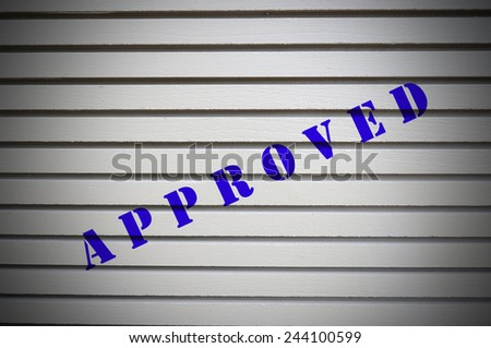 Approved message on gray wall. Business Concept. - stock photo