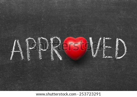 approved word handwritten on blackboard with heart symbol instead of O