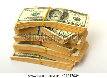 approximately eighty thousand American dollars spread on the stacks and strapped clerical gum - stock photo