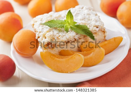 Apricot cake and fresh fruits