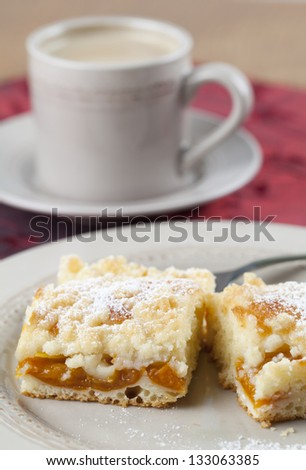 Apricot crumble cake and coffee. Shallow dof - stock photo