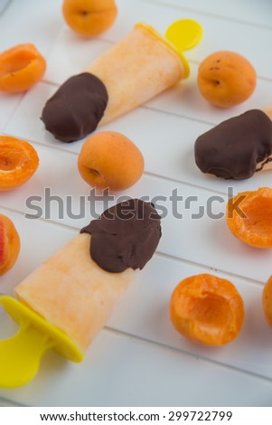 Apricot Popsicle with chocolate - stock photo