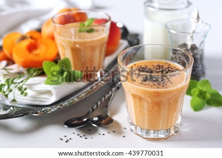 Apricot smoothie, milk and chia seeds - stock photo