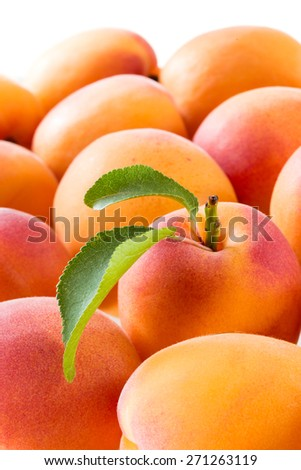 Apricot with leaf. Fruit background
