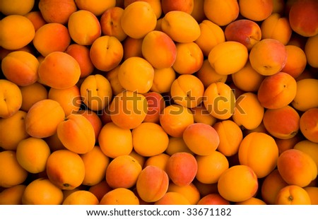Apricots in a local fresh fruit market - stock photo