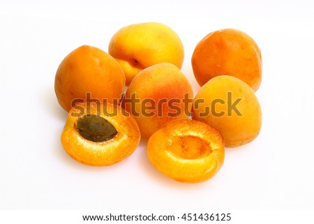 Apricots on a white cutting board made of plastic
