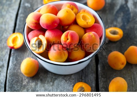 apricots on wooden surface - stock photo