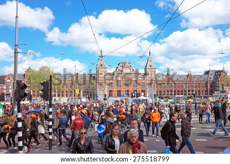 APRIL 27: Amsterdam at the Central Station during the celebration of kings day, april 27, 2015 in Amsterdam, The Netherlands - stock photo