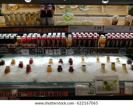 April 13, 2017 - Background: Assorted chilled organic fruit drink and salad on ice, display and ready to sell in grocery store in Kuala Lumpur, Malaysia
