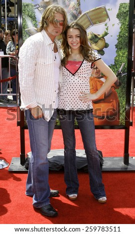 "April 30, 2006. Billy Ray Cyrus and daughter Destiny attend the Los Angeles Premiere of DreamWorks' ""Over The Hedge"" held at the Mann Village Theatre in Westwood, United States. - stock photo"