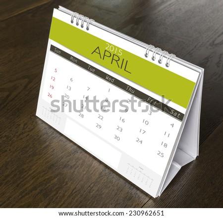 April Calendar 2015 on wood table - stock photo