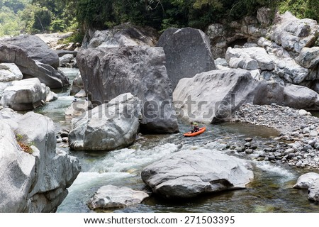 April 17,2015, Cangrejal River, Honduras: a kayak is negotiating the rapids at one of Honduras most popular whitewater rafting location - stock photo