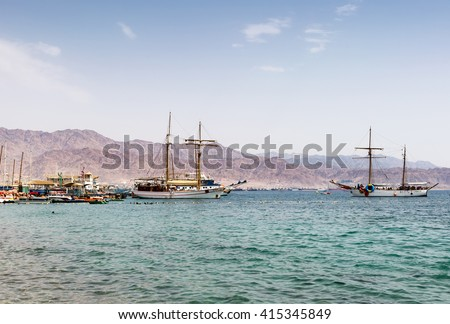 APRIL 5 EILAT, ISRAEL: beach of Eilat - famous resort and recreation city in Israel. April 5, 2016 in Eilat, Israel