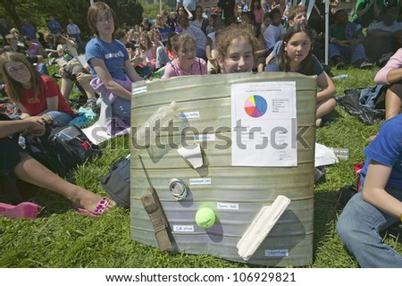 APRIL 2006 - Female student displays junk pulled out of river area for Earth Day event in Alexandria, Virginia for Earth Force - stock photo
