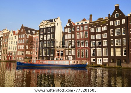 April 14, 2016. Holland, Amsterdam. Old houses in the canal.