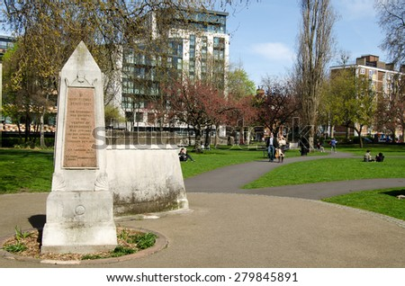 APRIL 12, 2015:  Londoners enjoying a sunny April day in the public park that used to be the churchyard of St Mary Magdalen Church in Bermondsey, inner London.   - stock photo