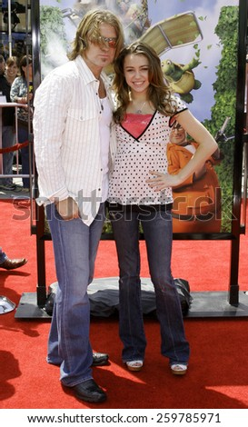 "April 30, 2006. Miley Cyrus and Billy Ray Cyrus at the Los Angeles Premiere of DreamWorks' ""Over The Hedge"" held at the Mann Village Theatre in Westwood, California United States.  - stock photo"