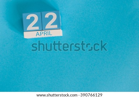 April 22nd. Earth Day. Image of april 22 wooden color calendar on blue background.  Spring day, empty space for text - stock photo
