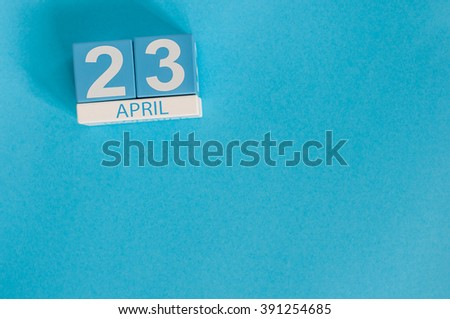 April 23rd. World Book Day. Image of april 23 wooden color calendar on blue background.  Spring day, empty space for text - stock photo