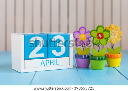 April 23rd. World Book Day. Image of april 23 wooden color calendar on white background with flowers. Spring day, empty space for text - stock photo