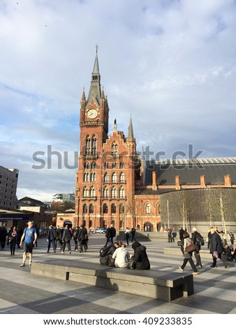 April 14 2016. St Pancras Station, London, England. Imposing clock tower at the station entrance set agains a cloudy bright morning sky. - stock photo