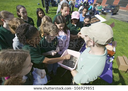 """APRIL 2006 - """"Students of """"Earth Force"""" environmental group at Earth Day event in Alexandria, Virginia on Potomac River"""" - stock photo"""