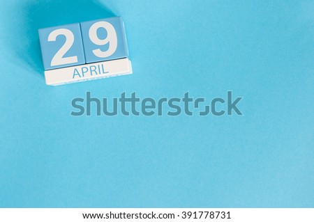 April 29th. Image of april 29 wooden color calendar on blue background.  Spring day, empty space for text. International or World Dance Day - stock photo