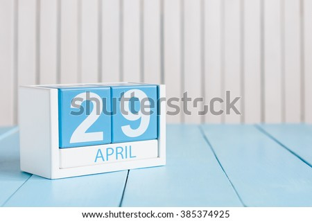 April 29th. Image of april 29 wooden color calendar on white background.  Spring day, empty space for text. International or World Dance Day