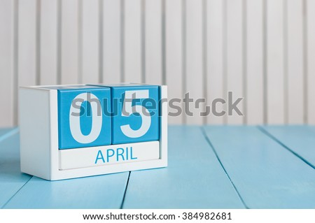 April 5th. Image of april 5 wooden color calendar on white background.  Spring day, empty space for text - stock photo