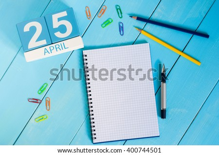 April 25th. International Day Of DNA. Image of april 25 wooden color calendar on blue background.  Spring day, empty space for text - stock photo