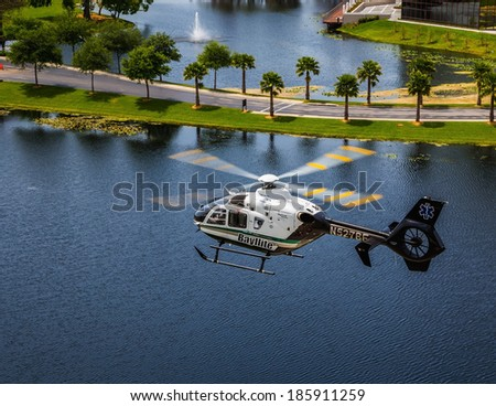 April 4th, 2014 Tampa Florida Bayflite Helicopter. Bayflight is a rescue helicopter that responds to Trauma rescue scenes and transports patients to the hospital trauma center. - stock photo