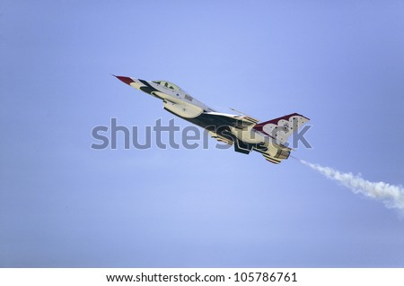 APRIL 2007 - US Air Force F-16C Fighting Falcons, known as the Thunderbirds, flying in blue sky over the 42nd Naval Base Ventura County Air Show at Point Mugu, Ventura County, Southern California.