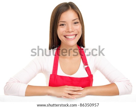 apron woman sales assistant clerk smiling happy with arms on edge for sign or similar. Beautiful content and joyful female model isolated on white background - stock photo