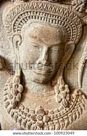 Apsara carved on the wall of Angkor Wat,  cambodia. - stock photo