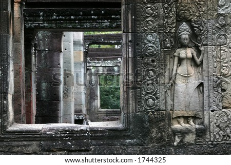 Apsara dancer at the bas-relief of Banteay Kdei Temple in the Angkor Area near Siem Reap, Cambodia. - stock photo