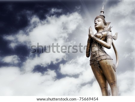 apsonsi-thai magnificent statue against cloudy sky background - stock photo