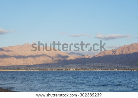 Aqaba, Jordan seen from Eilat gulf, Israel - stock photo