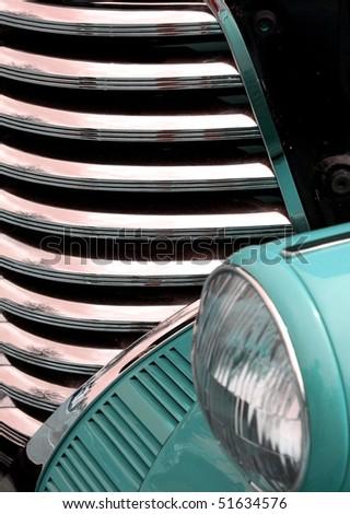 Aqua antique car grill and headlight - stock photo