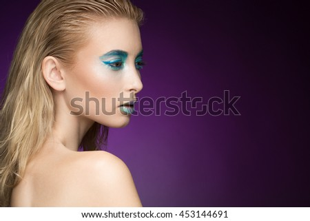 Aqua fashion. Shot of a stunning young fashion model wearing aquatic metallic makeup looking away copyspace on the side