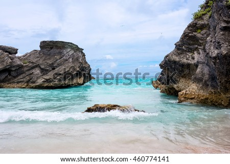Aqua marine colored water and rock formations of Horseshoe Bay Beach in Bermuda.