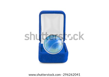 Aquamarine ring in blue jewel box on white background - stock photo