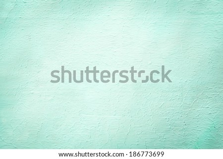 Aquamarine rough plaster surface finish background texture in a 2014 fashion color with a faint vignette and central copyspace - stock photo